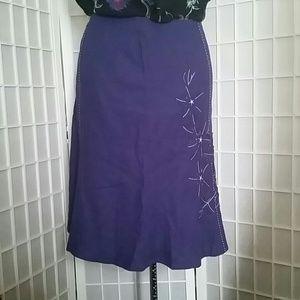 Plus size purple fluted skirt with floral applique